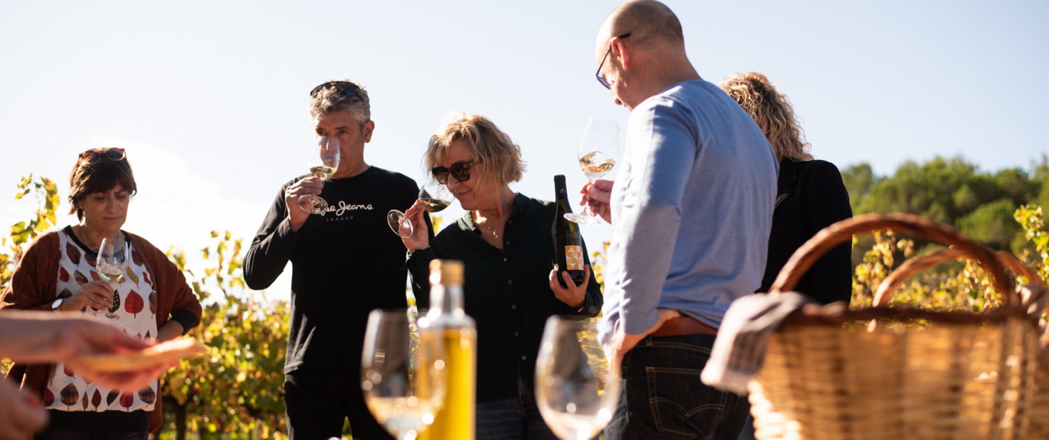 Three people trying wine in the open